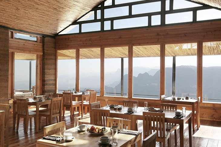 Limalimo Lodge restaurant with huge windows overlooking the mountains