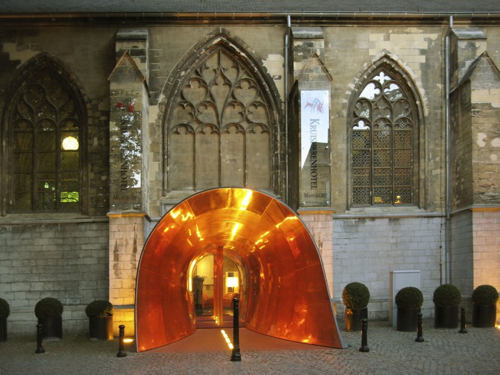 Kruisherenhotel gothic church entrance in a golden tunnel