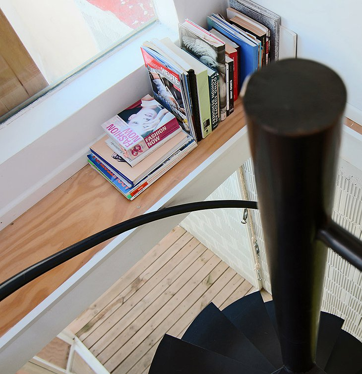 Book shelf at the spiral stairs