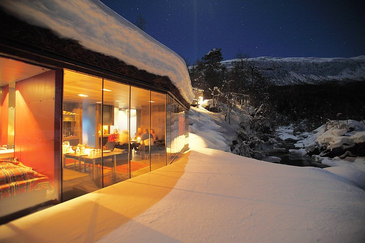 Juvet Landscape Hotel spa exterior in winter full of snow