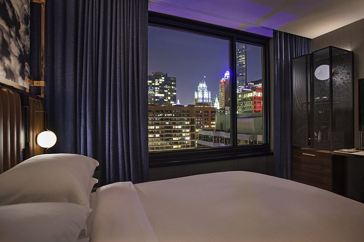 Hotel EMC2 Bedroom with Night Chicago View