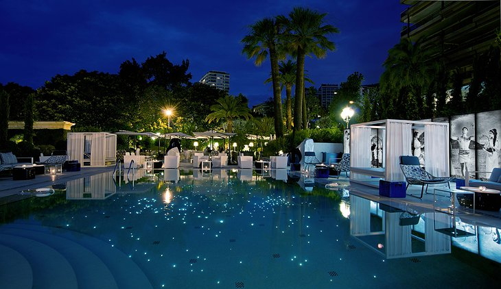 Glowing swimming pool at night at Hotel Metropole