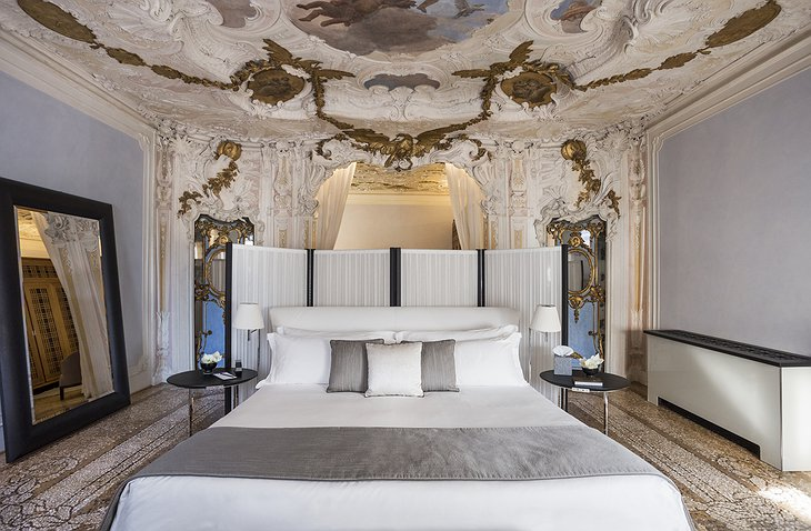 Aman Venice Grand Canal Hotel room with vintage ceiling