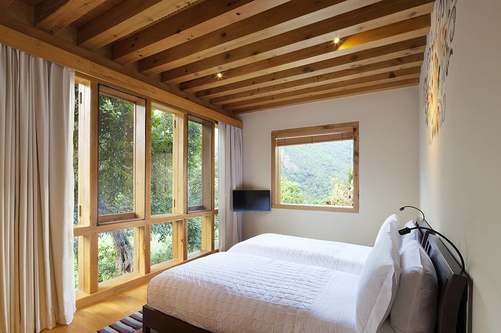COMO Uma Punakha bedroom with nature views