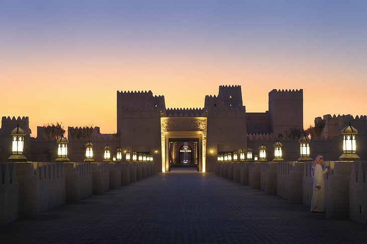 Qasr Al Sarab Desert Resort gate entrance at night