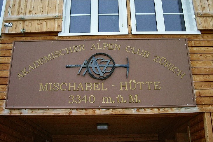 Mischabel Hut entrance sign showing the 3340 meters height where the hotel lies