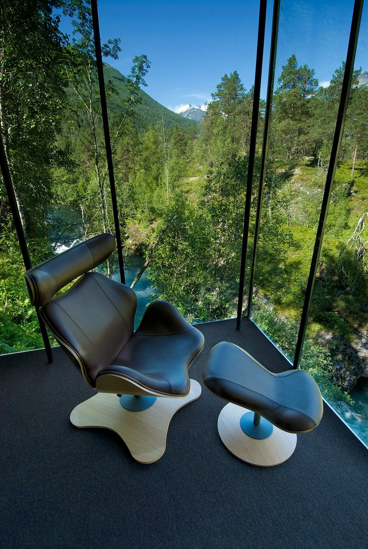 Juvet Landscape Hotel room with splendid nature view through the large glass window