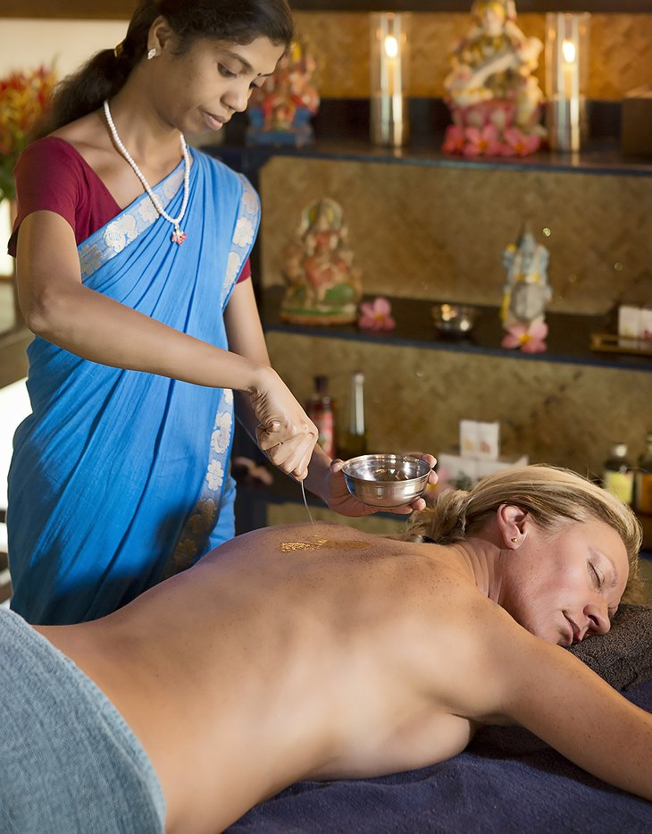 Woman getting Indian traditional massage