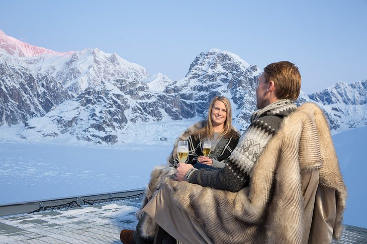 Sheldon Chalet Couple Enjoying Outdoor Champaign