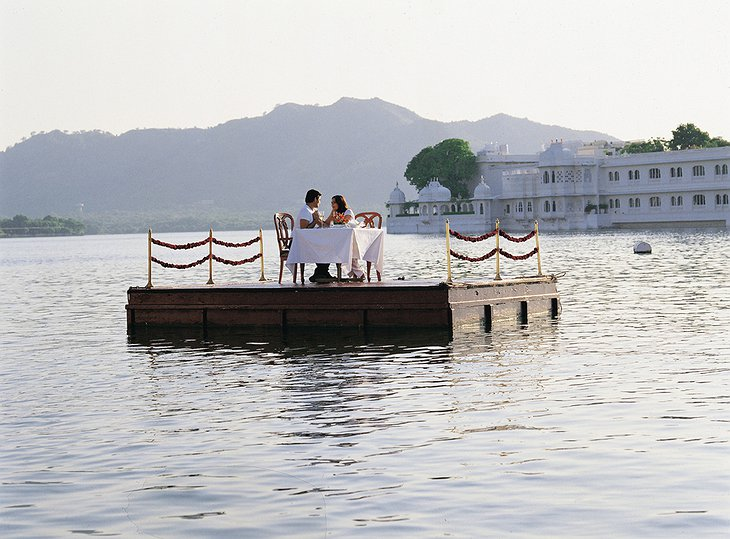 Romantic dining on a floating platform on the lake