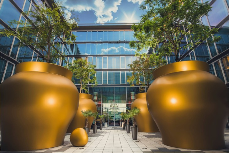 Kameha Grand Bonn entrance with large golden bowls for trees